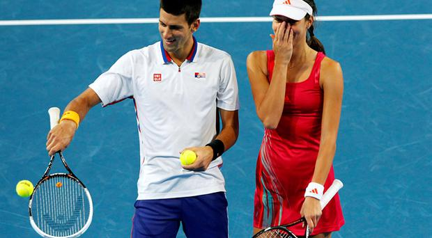 Novak Djokovic and Ana Ivanovic of Serbia share a laugh against Bernard Tomic and Ashleigh Barty of Australia during their mixed doubles match. Photo: Reuters