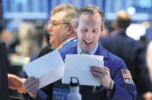 Traders work on the floor of the New York Stock Exchange. Photo: Getty Images