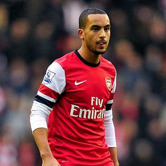 Arsene Wenger said talks are ongoing over a new deal for Theo Walcott, pictured