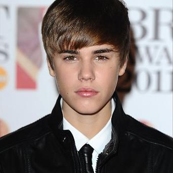 Justin Bieber has called for tougher laws to control paparazzi.