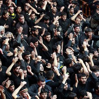Shiite Muslim worshippers beat themselves inside the holy shrine of Imam Hussein to mark the festival of Arbaeen in Karbala (AP)