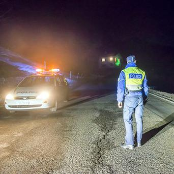 Police close off the road to Daillon, Switzerland, after a shooting (AP/Keystone)