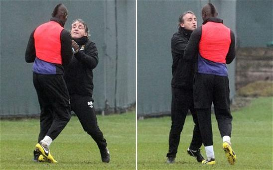 Manchester City striker Mario Balotelli tangles with manager Roberto Mancini during a bust-up at training
