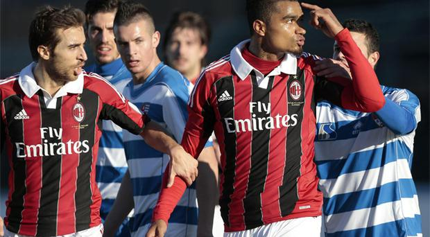 AC Milan midfielder Kevin-Prince Boateng is flanked by his teammate Mathieu Flamini after he was racially abused by opposition fans