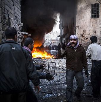 The UN says more than 60,000 people have been killed in Syria since the start of the uprising in March 2011 (AP/Andoni Lubaki)