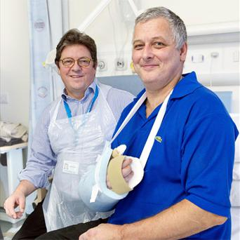 Professor Simon Kay (left) and Mark Cahill (right) who has become the first person in the UK to have a hand transplant. Photo: PA