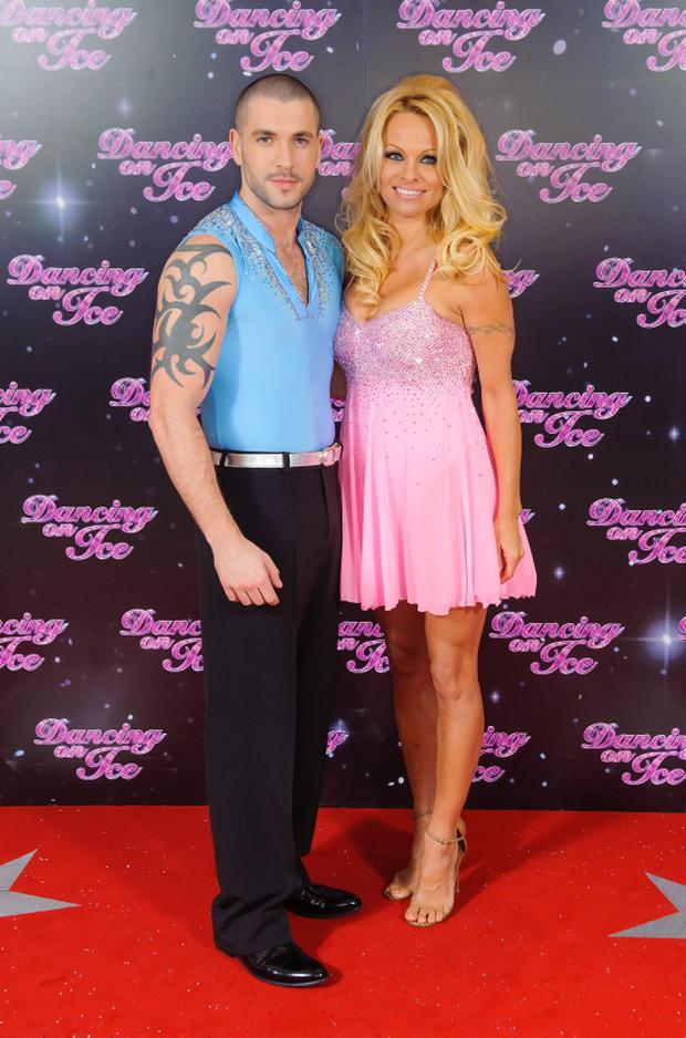 Shayne Ward (left) and Pamela Anderson at a photocall for the launch of the new series of 'Dancing on Ice' at the ITV Studios, in central London. PRESS ASSOCIATION Photo. Picture date: Thursday January 3, 2013. Photo credit should read: Dominic Lipinski/PA Wire