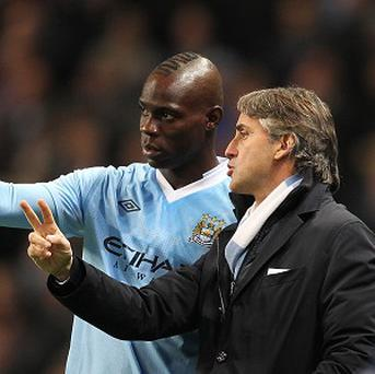 Roberto Mancini, right, and Mario Balotelli, left, were involved in a training ground confrontation