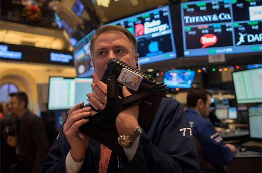 A trader works on the floor of the New York Stock Exchange in New York. Photo: Reuters
