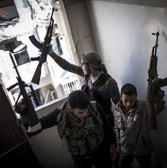 Free Syrian Army members fighting in the city of Aleppo (AP)