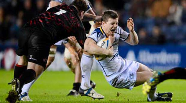 Brian O'Driscoll is tackled by Allan Jacobsen of Edinburgh.