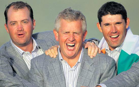 Padraig Harrington,celebrating 2010 Ryder Cup glory with team captain Colin Montgomerie and Peter Hanson.