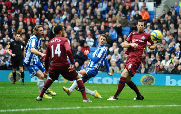 Brighton and Hove Albion's Andrea Orlandi scores his sides first goal during the FA Cup Third round match at the AMEX Stadium, Brighton. PRESS ASSOCIATION Photo. Picture date: Saturday January 5, 2012. See PA story SOCCER Brighton. Photo credit should read: Clive Gee/PA Wire. RESTRICTIONS: Editorial use only. Maximum 45 images during a match. No video emulation or promotion as 'live'. No use in games, competitions, merchandise, betting or single club/player services. No use with unofficial audio, video, data, fixtures or club/league logos.