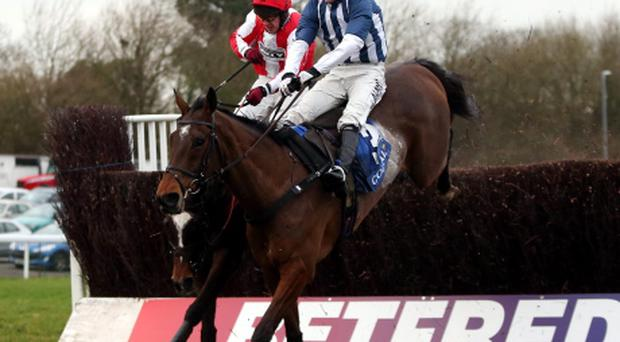 Teaforthree ridden by Tony McCoy jumps the last with eventual winner Monbeg Dude ridden by Paul Carberry in the Coral Welsh National Handicap Chase during the Coral Welsh Grand National Day at Chepstow Racecourse, Chepstow. PRESS ASSOCIATION Photo. Picture date: Saturday January 5, 2013. See PA story RACING Chepstow. Photo credit should read: David Davies/PA Wire
