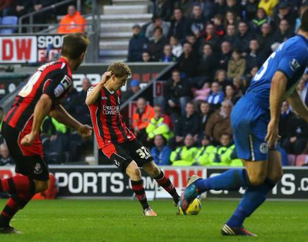 WIGAN, ENGLAND - JANUARY 05: Eunan O'Kane of AFC Bournemouth scores the opening goal during the Budweiser FA Cup Third Round match between Wigan Athletic and AFC Bournemouth at DW Stadium on January 5, 2013 in Wigan, England. (Photo by Alex Livesey/Getty Images)