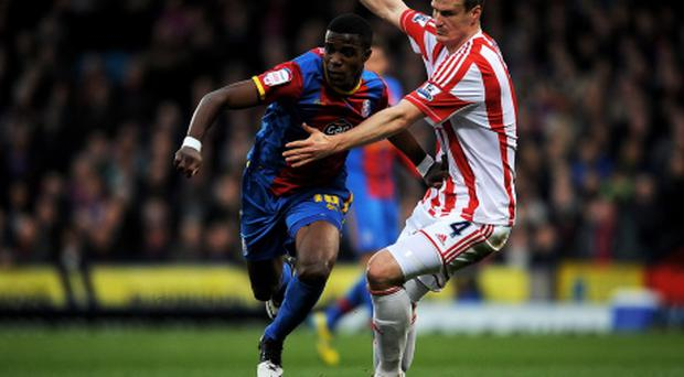 LONDON, ENGLAND - JANUARY 05: Wilfried Zaha of Crystal Palace is challenged by Robert Huth of Stoke during the FA Cup with Budweiser Third Round match between Crystal Palace and Stoke City at Selhurst Park on January 5, 2013 in London, England. (Photo by Christopher Lee/Getty Images)