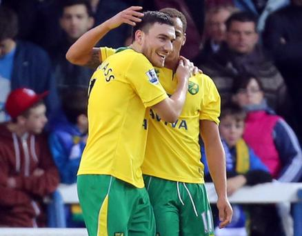 Norwich City's Elliott Bennett (right) celebrates scoring his sides opening goal with Robert Snodgrass during the FA Cup Third Round match at London Road, Peterborough. PRESS ASSOCIATION Photo. Picture date: Saturday January 5, 2013. See PA story SOCCER Peterborough. Photo credit should read: Chris Radburn/PA Wire. RESTRICTIONS: Editorial use only. Maximum 45 images during a match. No video emulation or promotion as 'live'. No use in games, competitions, merchandise, betting or single club/player services. No use with unofficial audio, video, data, fixtures or club/league logos.
