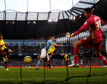 Manchester City's Gareth Barry (C) heads the ball to score his team's second goal during their FA Cup soccer match against Watford at The Etihad Stadium in Manchester, northern England January 5, 2013. REUTERS/Phil Noble (BRITAIN - Tags: SPORT SOCCER)