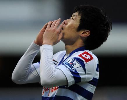 Queens Park Rangers' Ji-Sung Park rues a missed chance during the FA Cup Third Round match at Loftus Road, London. PRESS ASSOCIATION Photo. Picture date: Saturday January 5, 2013. See PA story SOCCER QPR. Photo credit should read: Andrew Matthews/PA Wire. RESTRICTIONS: Editorial use only. Maximum 45 images during a match. No video emulation or promotion as 'live'. No use in games, competitions, merchandise, betting or single club/player services. No use with unofficial audio, video, data, fixtures or club/league logos.