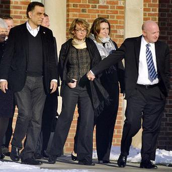 Gabrielle Giffords, centre, and husband Mark Kelly after meeting families of victims of the Connecticut school massacre (AP/The News-Times, Jason Rearick)