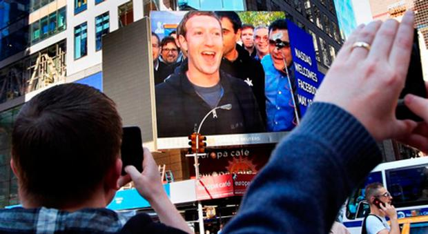 Mark Zuckerberg, seen on a screen televised from Facebook's headquarters in Menlo Park moments after the IPO launch