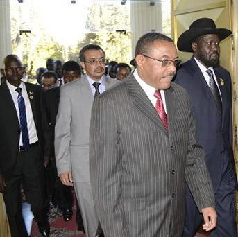 President Salva Kiir, right, of South Sudan arrives at the National Palace with PM Hailemariam Dessalegn, left, of Ethiopia during talks in Addis Ababa (AP)