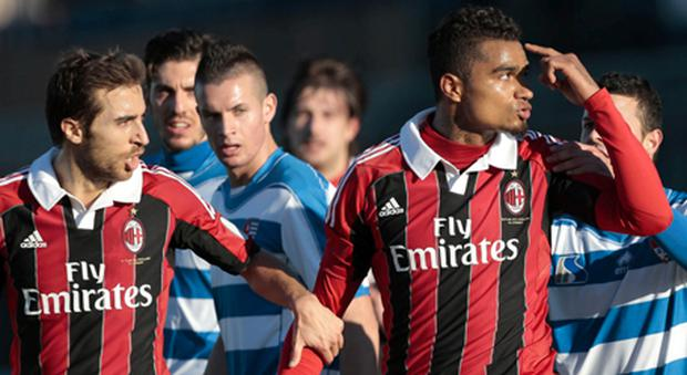 AC Milan Ghana midfielder Kevin-Prince Boateng, (right) is flanked by his teammate Mathieu Flamini as he gestures towards the crowd. A friendly match between AC Milan and lower division club Pro Patria was abandoned Thursday after racist chants were directed at Milan's black players.