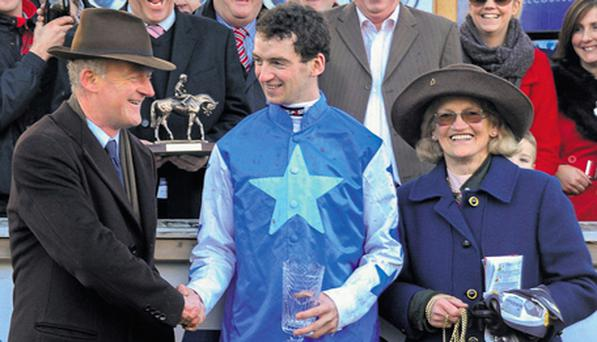 Patrick Mullins is congratulated by his father Willie and his grandmother Maureen.