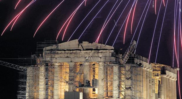 HOPING FOR A BETTER 2013: Fireworks explode over the Parthenon during New Year celebrations in Athens last week.