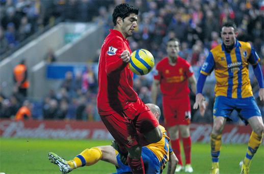 Luis Suarez appears to control the ball with his hand before scoring Liverpool's winning goal in the FA Cup Third round clash against Mansfield Town