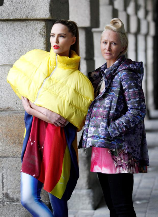 Repro Free: 06/01/2013 Designer Helen Steele is pictured with model Sarah Morrissey wearing a her duvet jacket and hand printed leggings and t-shirt showcasing the best of Showcase Fashion 2013. Showcase, Irelands Creative Expo and the countrys largest international trade fair, returns to the RDS this January, attracting buyers from over 17 countries keen to discover exciting and innovative new Irish products. Now in its 37th year, Showcase features over 400 of Irelands leading designers, manufacturers and craftspeople delivering high quality products that are often unique to the show. This years event, which takes place at the RDS from January 20th to 23rd 2013, focuses on two key strands Fashion & Jewellery and Home & Giftware, with other exciting features such as Creative Island, an expanded Enterprise Zone, Selected at Showcase and the Showcase Awards Programme, networking events and the popular seminar programme featuring top international industry experts. Pic Andres Poveda