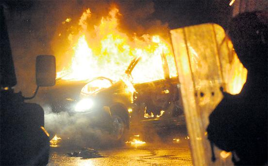 A car burns during disturbances which erupted in east Belfast