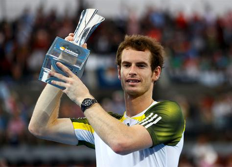 Andy Murray of Britain poses with the trophy after defeating Grigor Dimitrov of Bulgaria in their men's final match at the Brisbane International tennis tournament. Photo: Reuters