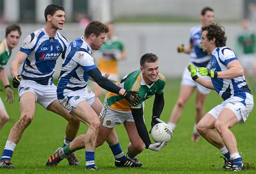 Offaly's Ross Brady is surrounded by Laois trio (from left) Brendan Quigley, Paul Begley and Padraig McMahon
