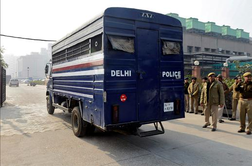 A police van carrying five men accused of the gang rape and murder of an Indian student arrives at a court in New Delhi. Photo: Reuters