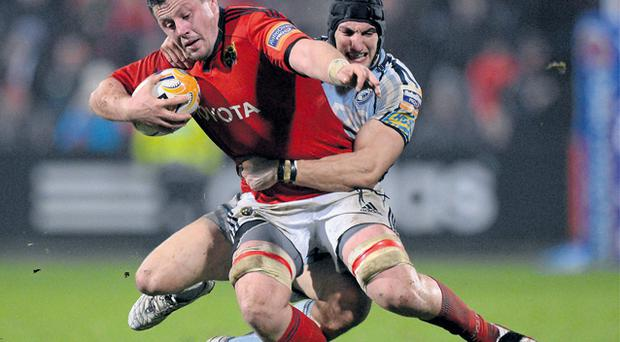 James Coughlan is tackled by Sam Warburton at Musgrave Park
