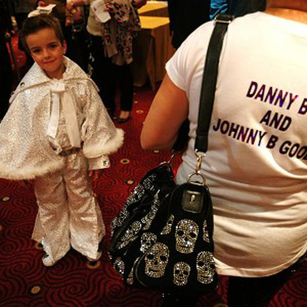 John Paul Melling, aged six, alias Johnny B Goode, waits to perform during the under-14 European Elvis Championships
