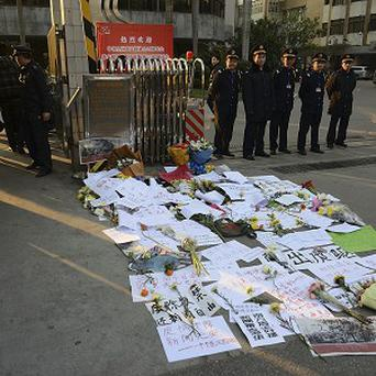 Protest banners laid outside the newspaper's offices (AP)