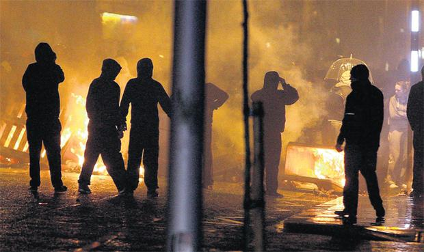 Loyalists set up burning barricades on the Newtownards Road in Belfast a month after the City Council decided to fly the union flag on designated days only