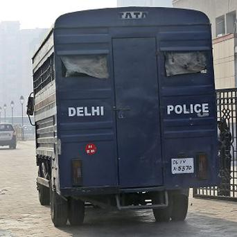 A police van believed to carrying five men accused of a gang rape arrives at the district court in New Delhi (AP)