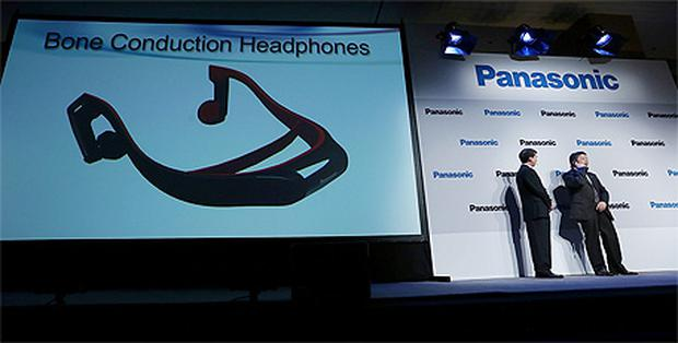 Shiro Kitajima, right, President of Panasonic Consumer Marketing, demonstrates Bone Conduction Headphones at the 2013 International CES