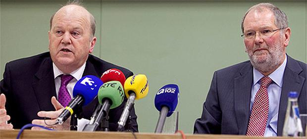 Finance Minister, Michael Noonan, and John Corrigan, Chief Executive, NTMA