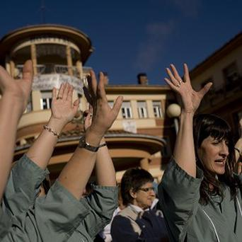 Spanish health workers protest against cuts (AP)