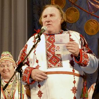Depardieu with his Russian passport (AP)