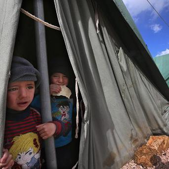 Syrian refugees in a border camp (AP)