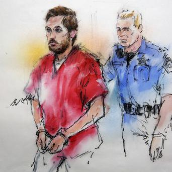 This courtroom sketch shows James Holmes being escorted by a deputy as he arrives at district court in Centennial (AP)