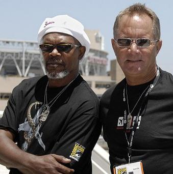 Samuel L Jackson, left, has paid tribute to director David R Ellis, right, who has died at the age of 60