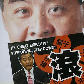 Pictures of Hong Kong's leader Leung Chun-ying displayed by pro-democracy protesters outside the Legislative Council (AP)