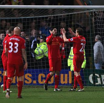 Luis Suarez, centre, scored Liverpool's second goal against Mansfield