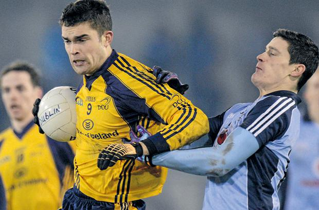 Craig Dunleavey of DCU holds off the challenge of Diarmuid Connolly at Parnell Park